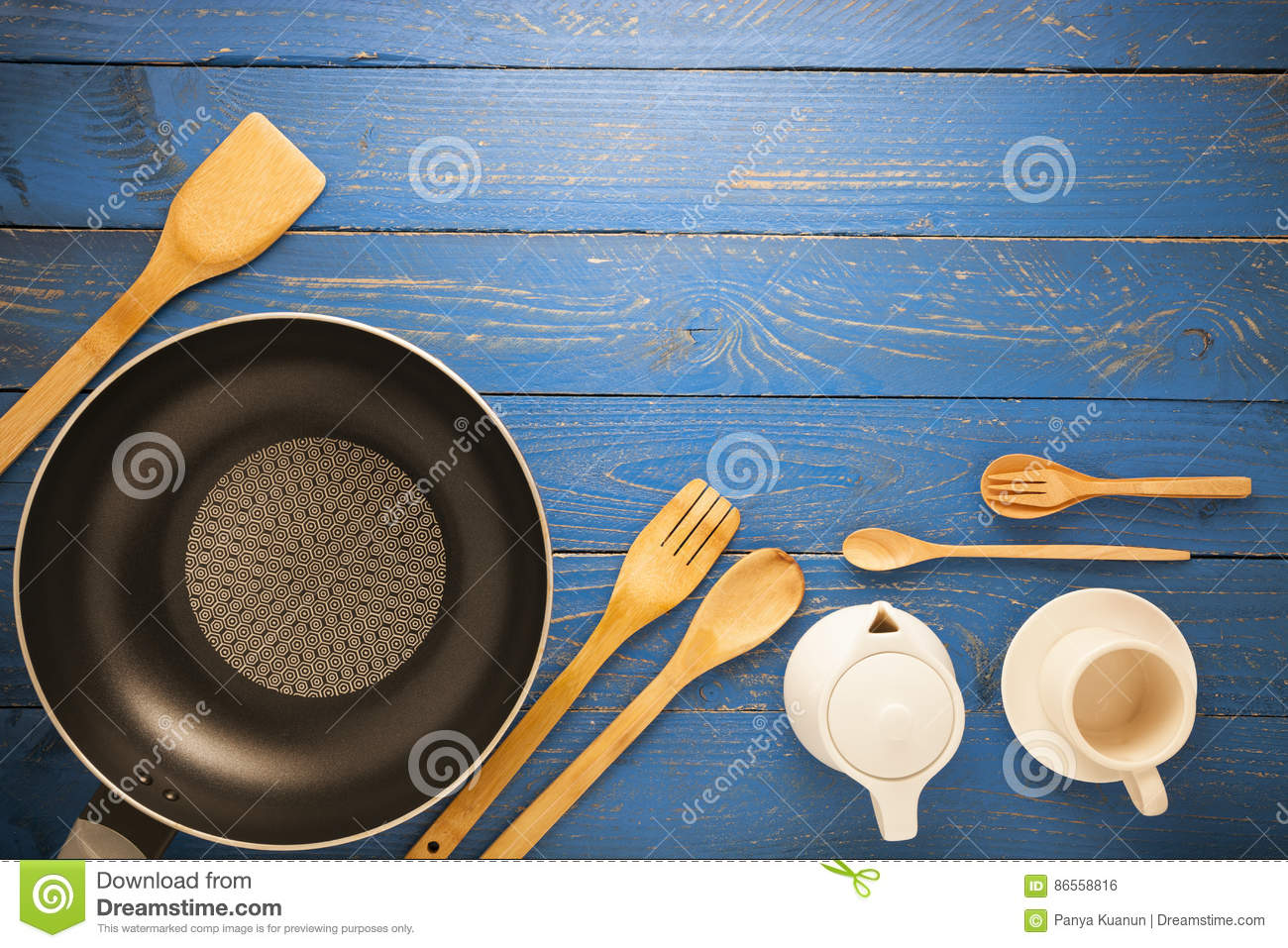 Black Frying Pan With Cooking Utensils On Blue Wood Table Backgr ...