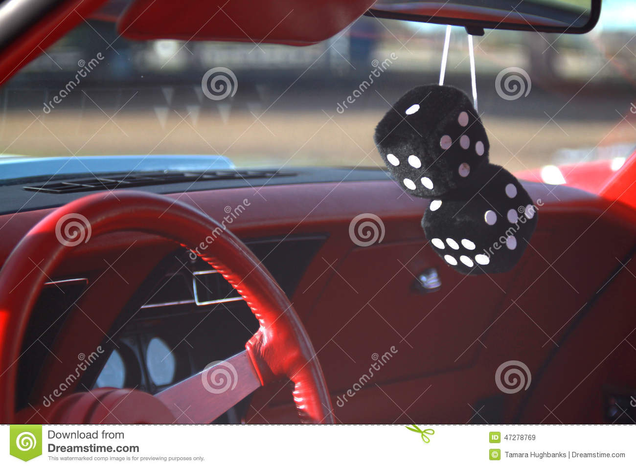 black fuzzy dice hanging from the rear view mirror stock photo image 47278769. Black Bedroom Furniture Sets. Home Design Ideas