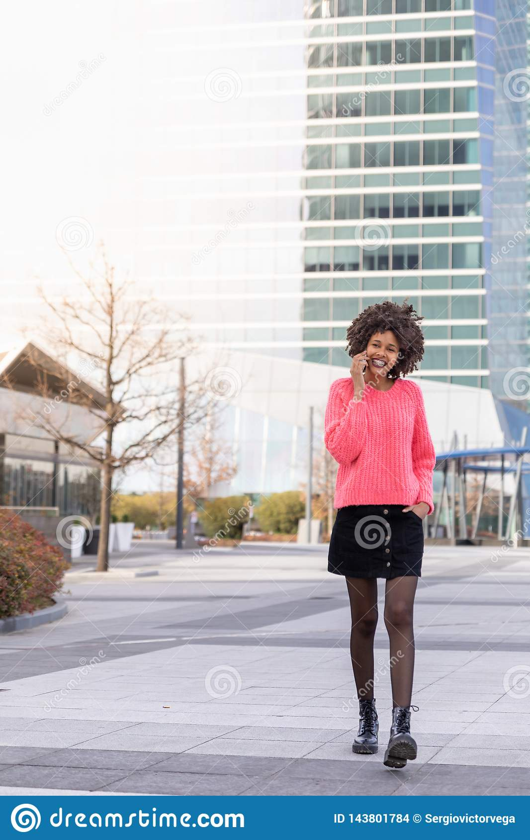 Black girl with the phone around the city