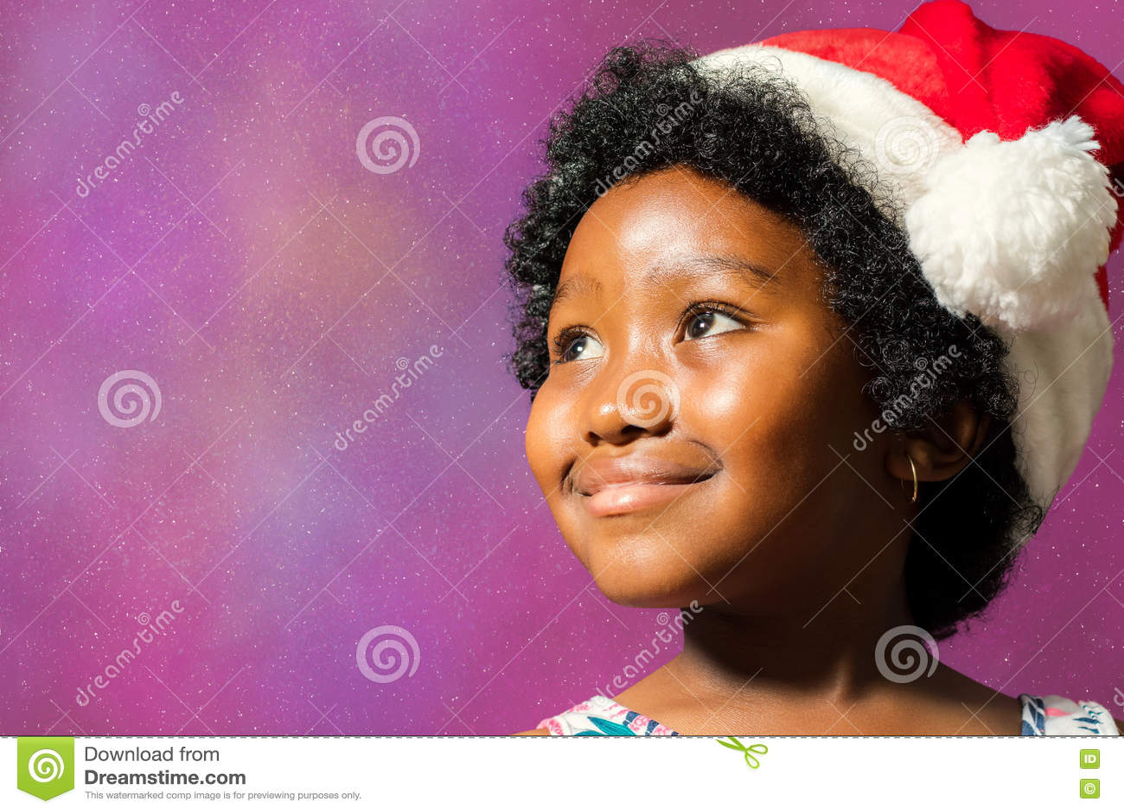 Christmas Hairstyles For Black Girls.Black Girl Wearing Christmas Hat Looking At Corner Stock