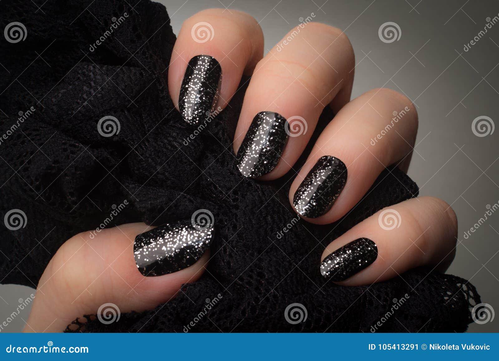 Black glittered nails