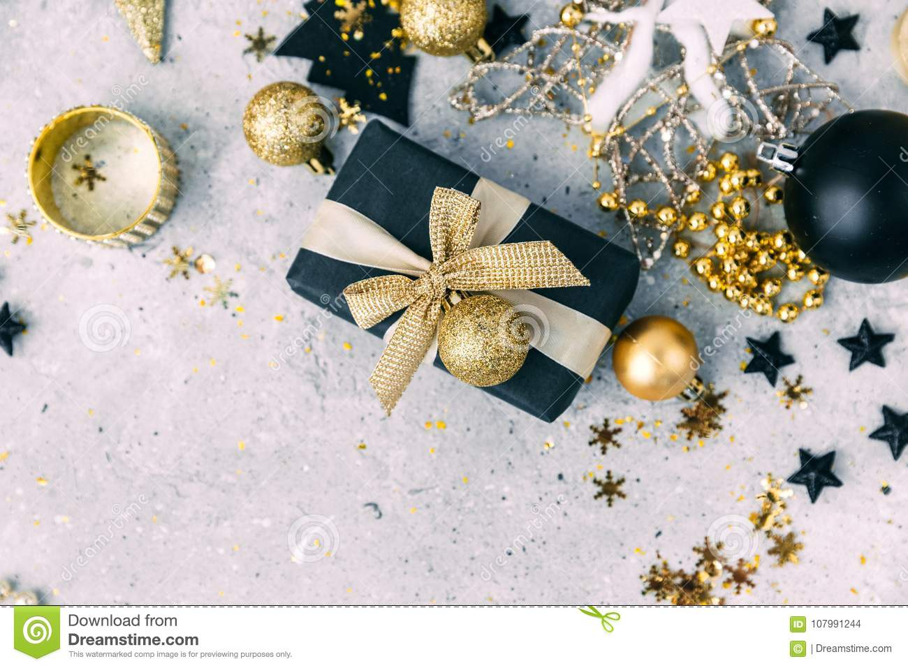 Black And Gold Christmas Decorations With Gift Box Stock Photo
