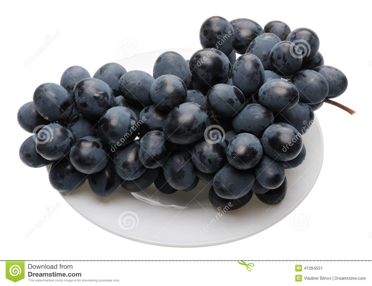 Black grapes on the plate