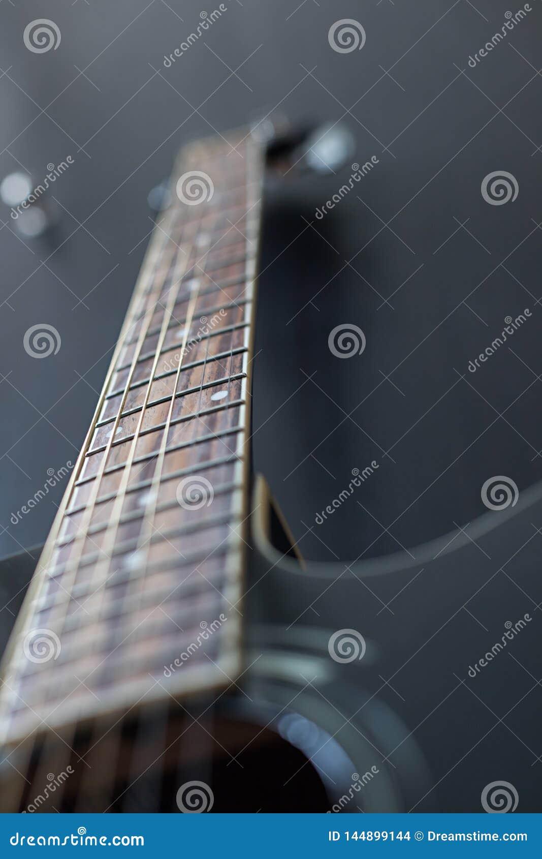 Black guitar on black background
