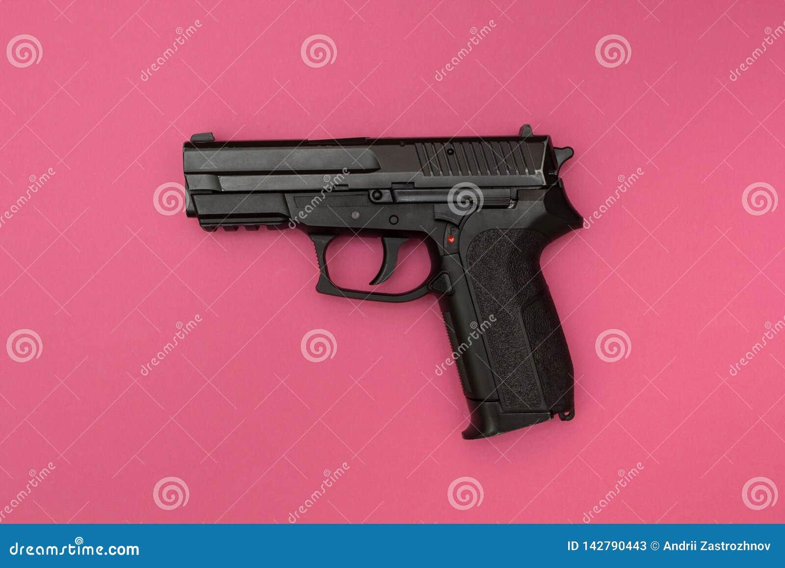 Black gun on a pink background