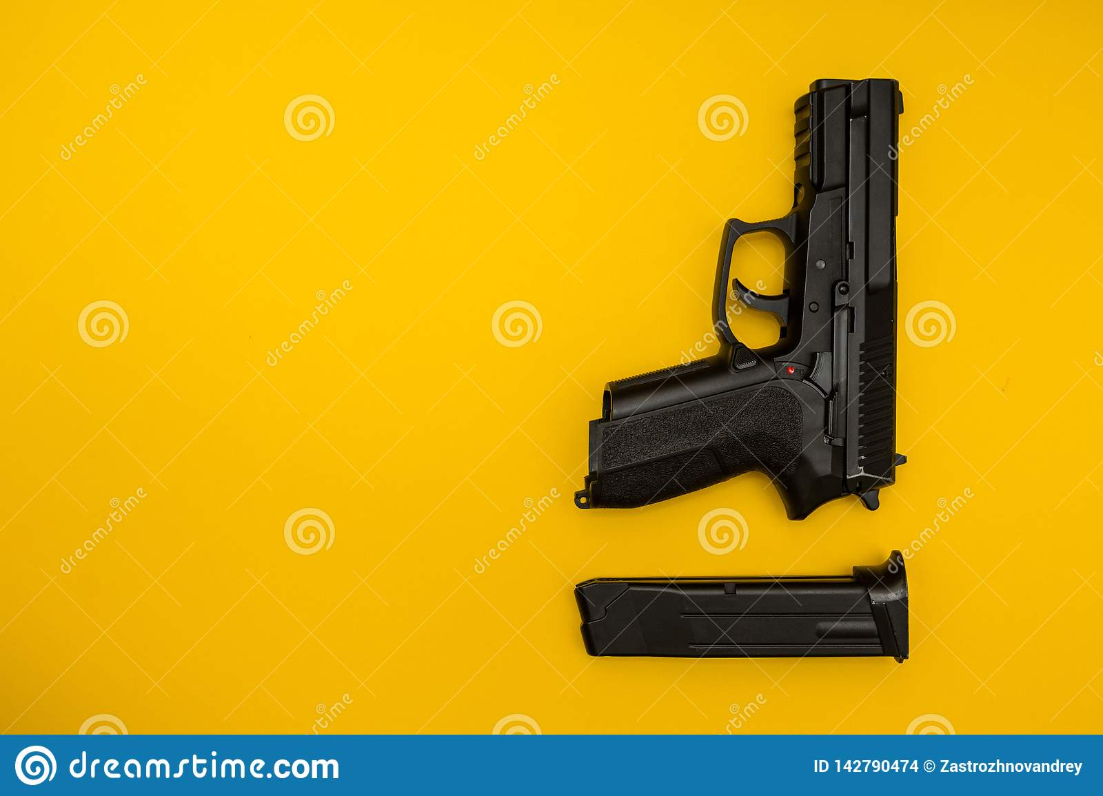 Black gun on a yellow background