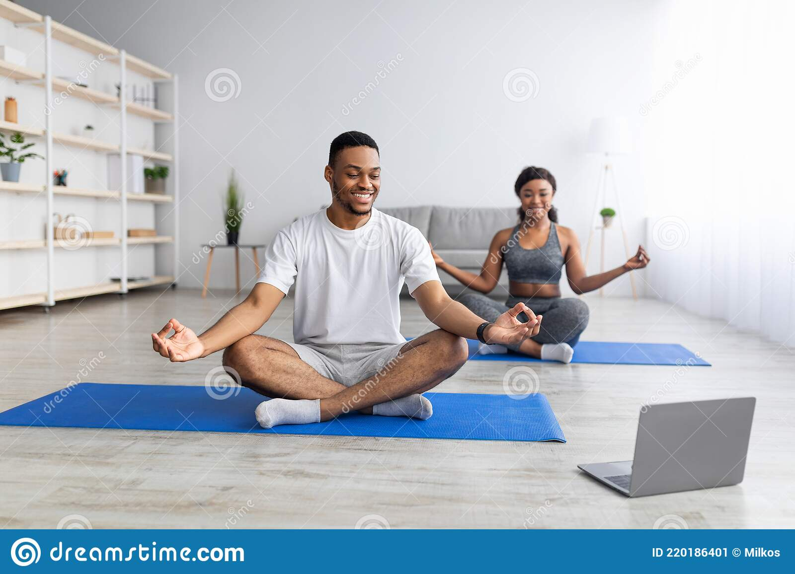 Black Guy Doing Online Yoga Practice With His Girlfriend, Sitting ...