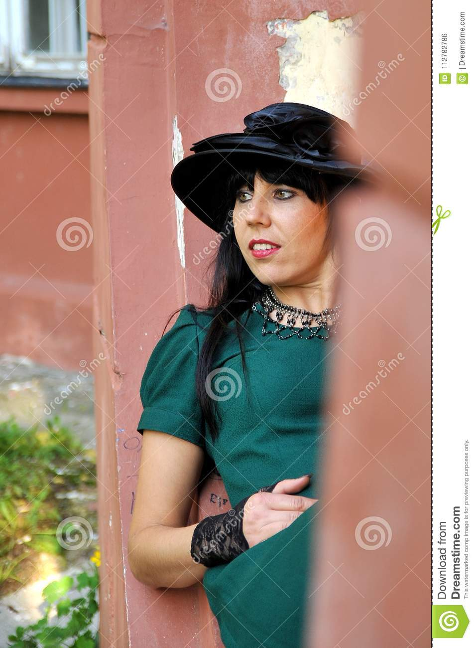 69089aed784 Black Hair Women On Green Dress With Black Hat Stock Photo - Image ...