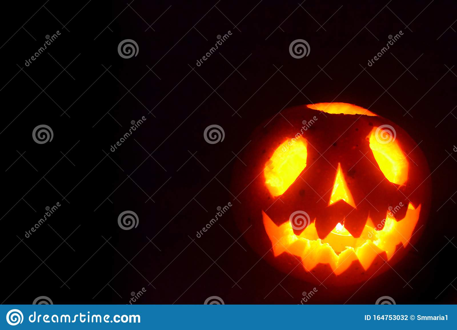 Black Halloween Background With A Glowing Jack O Lantern Photo Of Scary Pumpkin Stock Photo Image Of Card Festive 164753032
