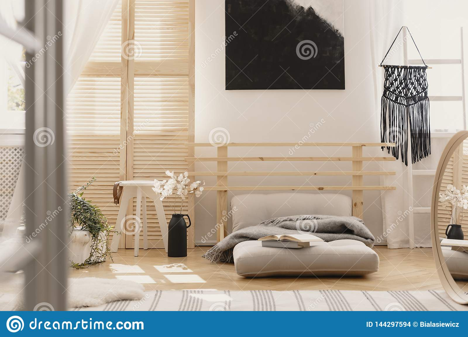 Black Handmade Macrame On White Wooden Ladder In Bright Bedroom Interior With Wooden Furniture And Beige Futon With Grey Warm Stock Photo Image Of Flat Macrame 144297594