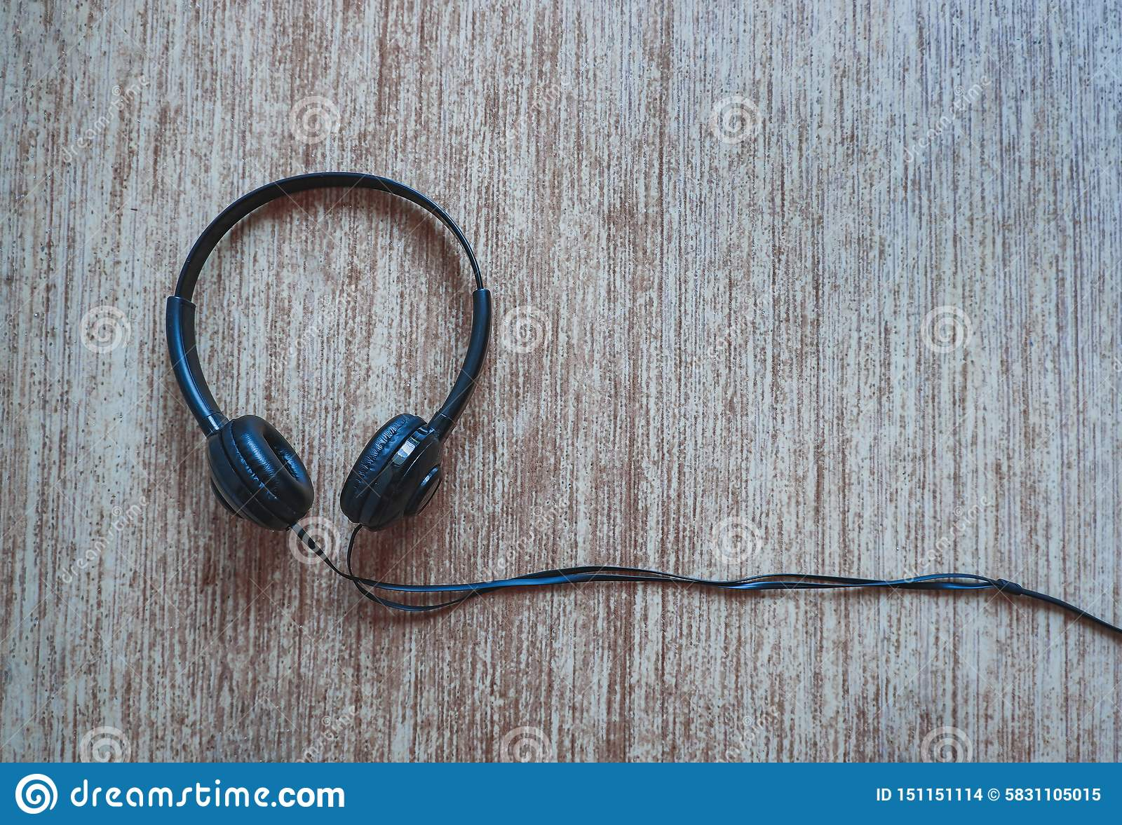 Black headphone with rustic background