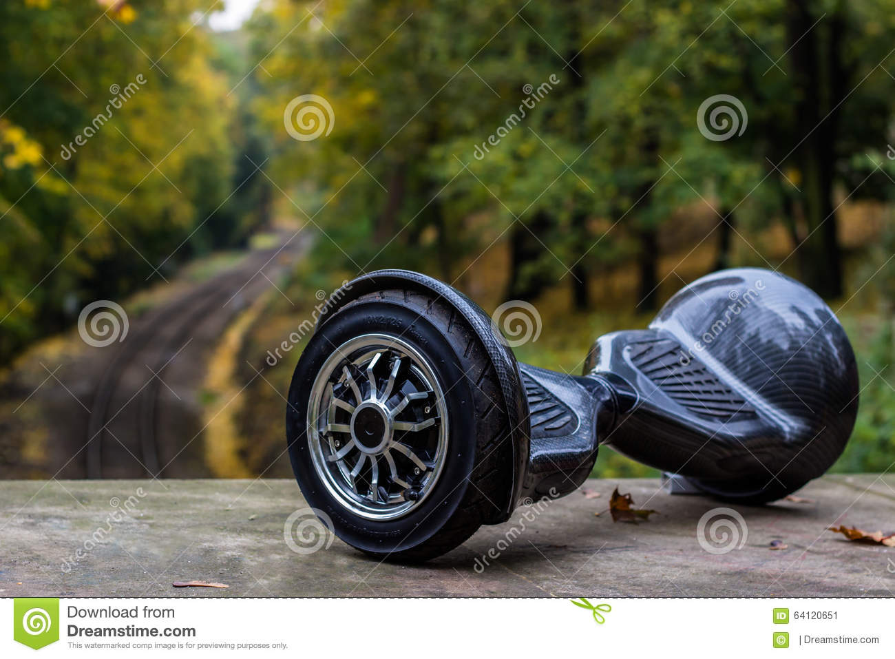 Black hoverboard against the background of railroad rails