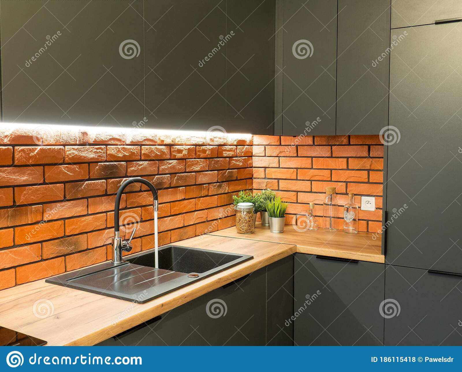 Black Kitchen Sink And Tap Water In The Modern Red And Gray Kitchen Stock Photo Image Of Sink Contemporary 186115418