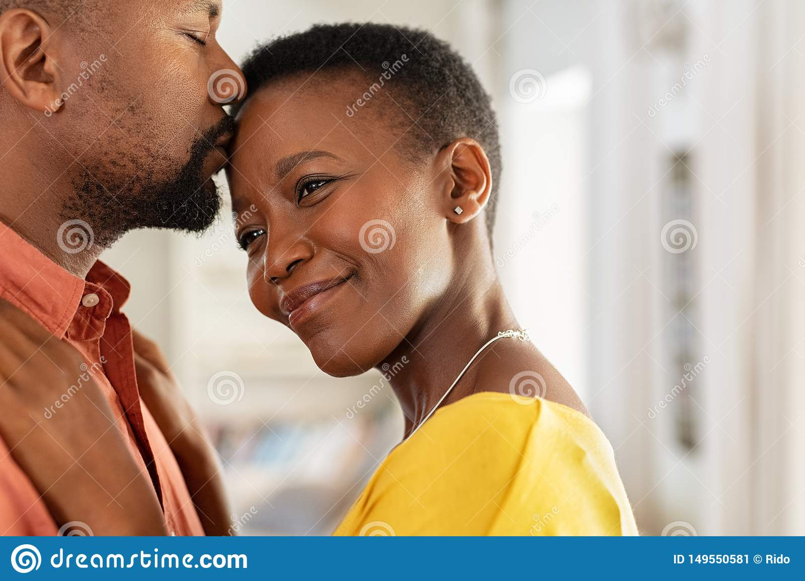 Black Man Kissing His Wife On Forehead Stock Image Image Of Closeup Relationship 149550581