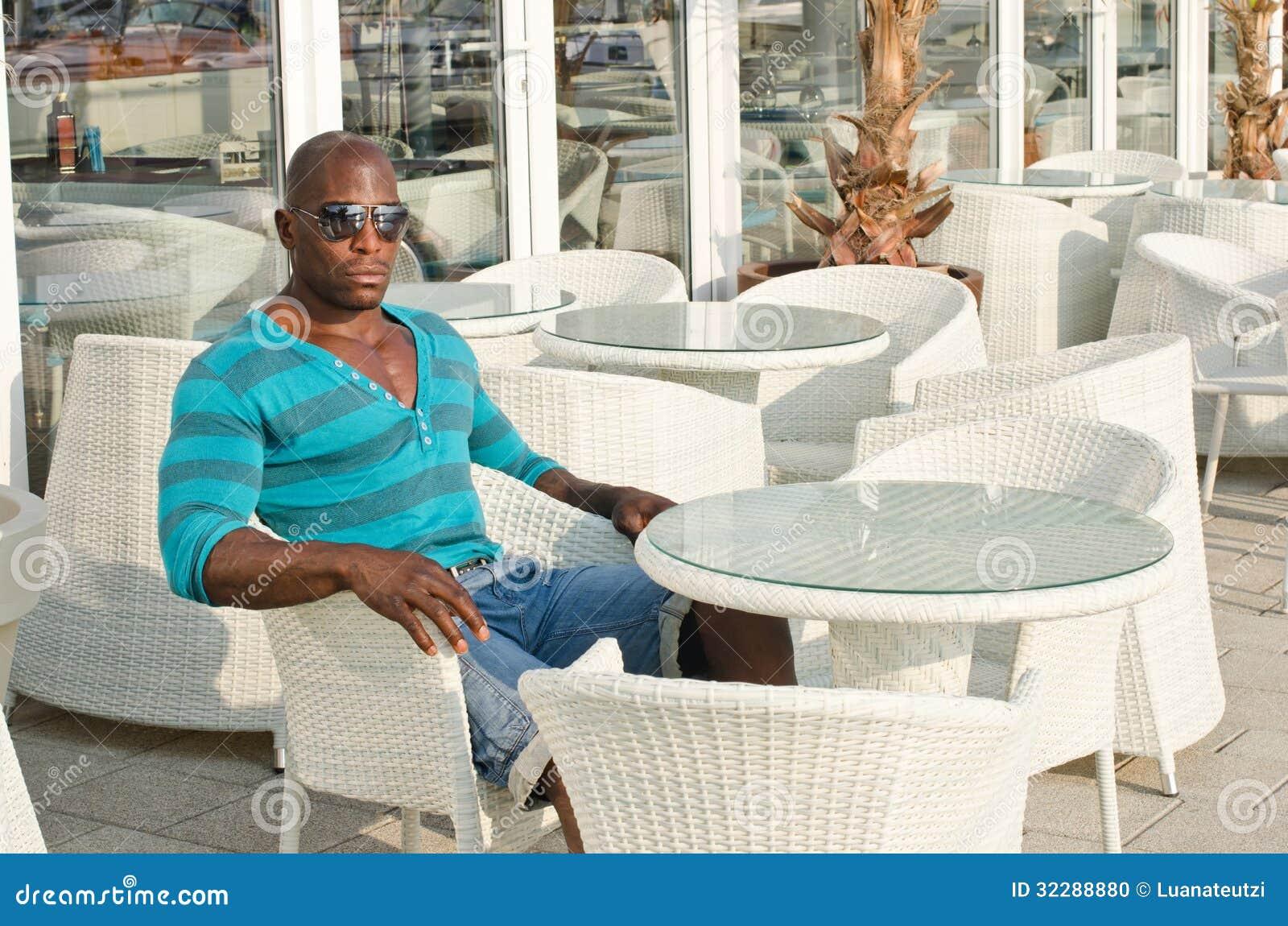 Black Man Sitting At A Bar Stock Photo Image 32288880