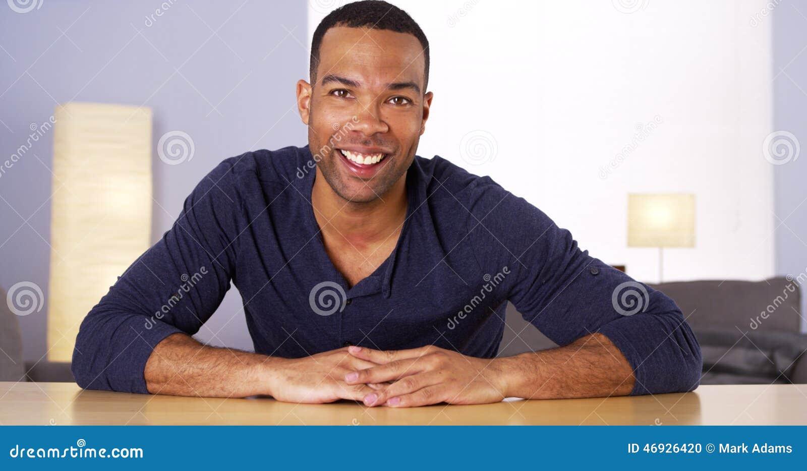 Black Man Smiling At Camera Stock Photo