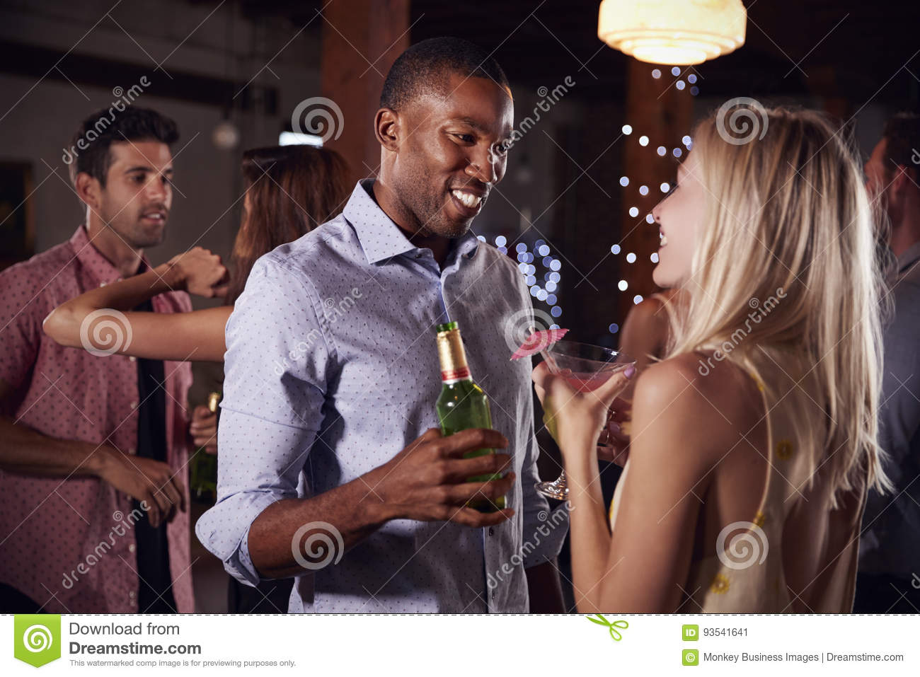 Black Man And White Woman Talking At A Party, Side View -8264