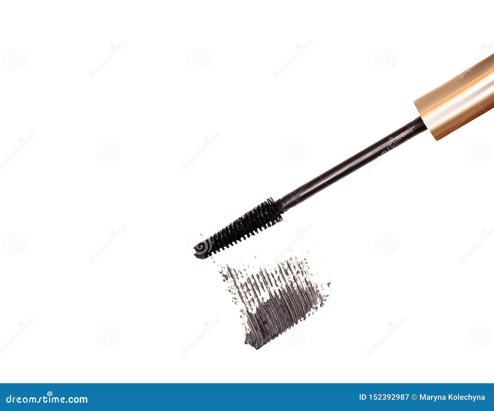 Black mascara brush stroke with applicator brush isolated on white background