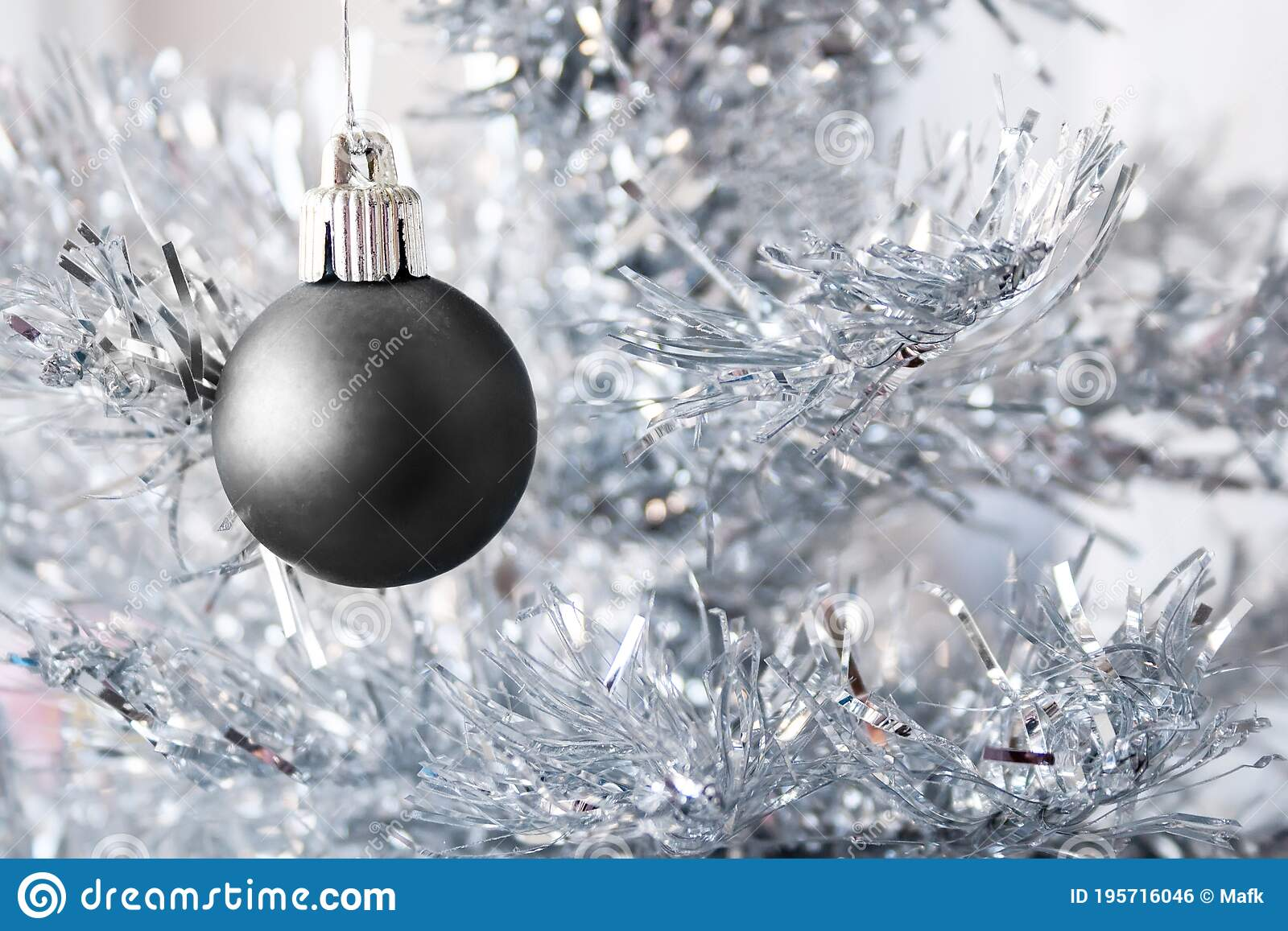 Black Matte Metallic Ball Hanging On A Silver Artificial Christmas Tree With Copy Space Selective Focus Blurred Background Stock Photo Image Of Celebrate Ball 195716046