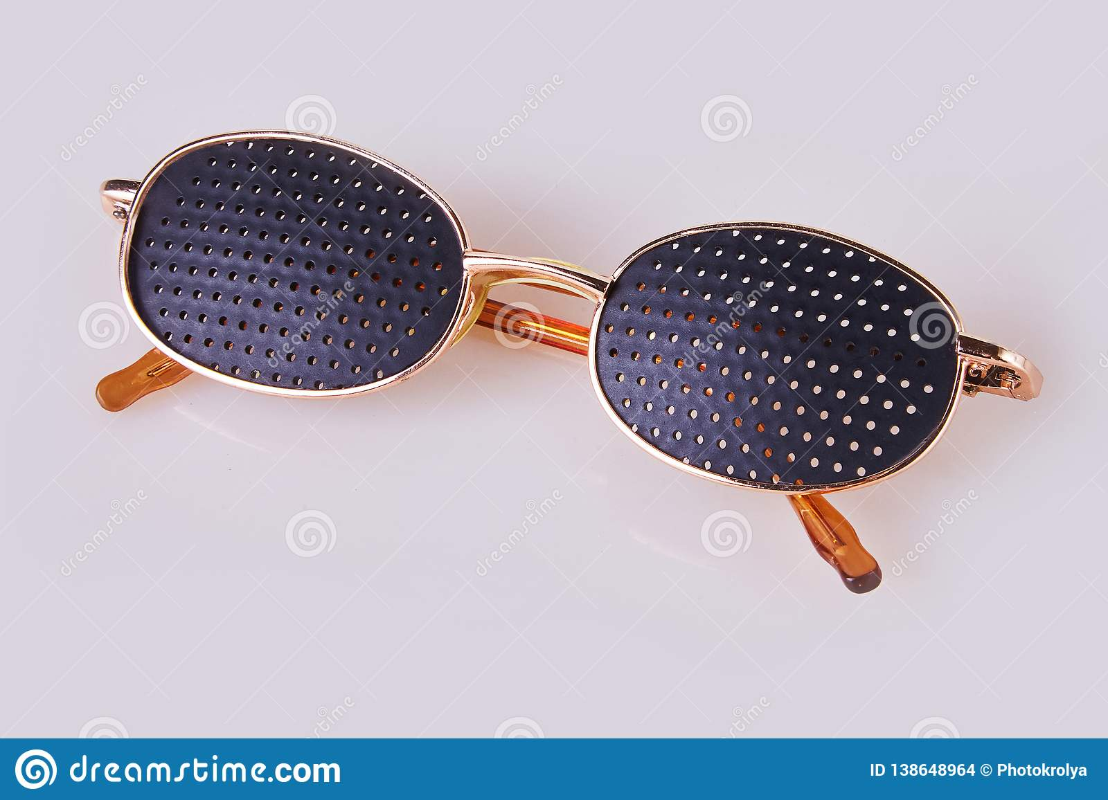 Black medical glasses with holes isolated on white background.