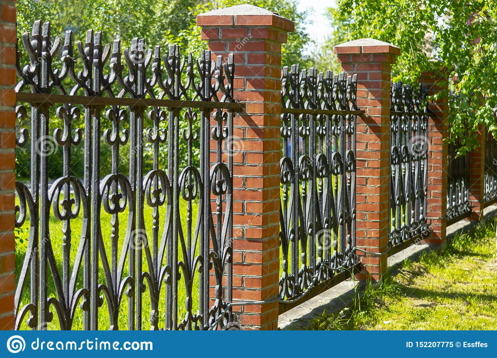 Picture of: Black Metal Fence With Brick Pillars Stock Image Image Of Elements Security 152207775