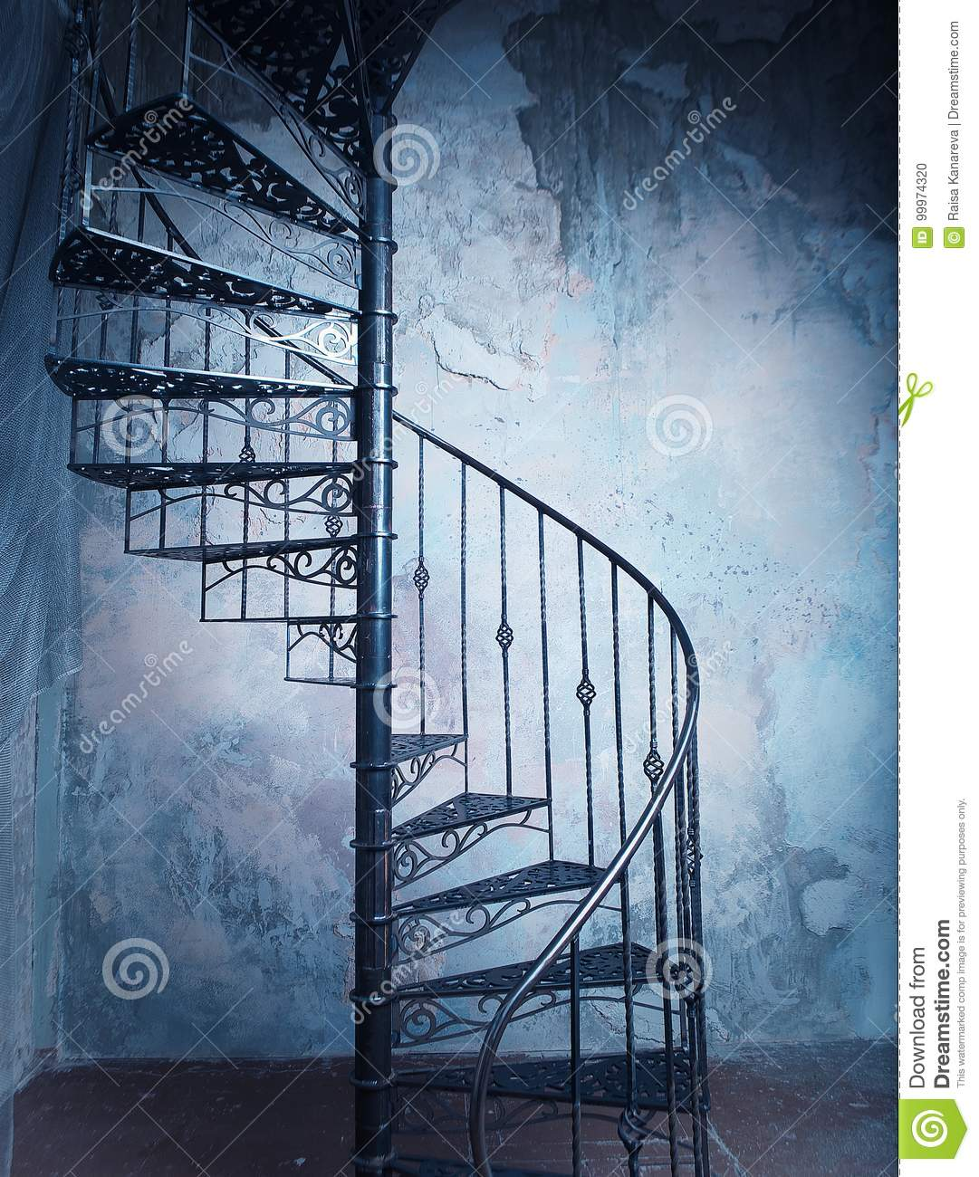 Accent Wall For Circular Staircase: Metal Spiral Staircase Against The Old Wall Background