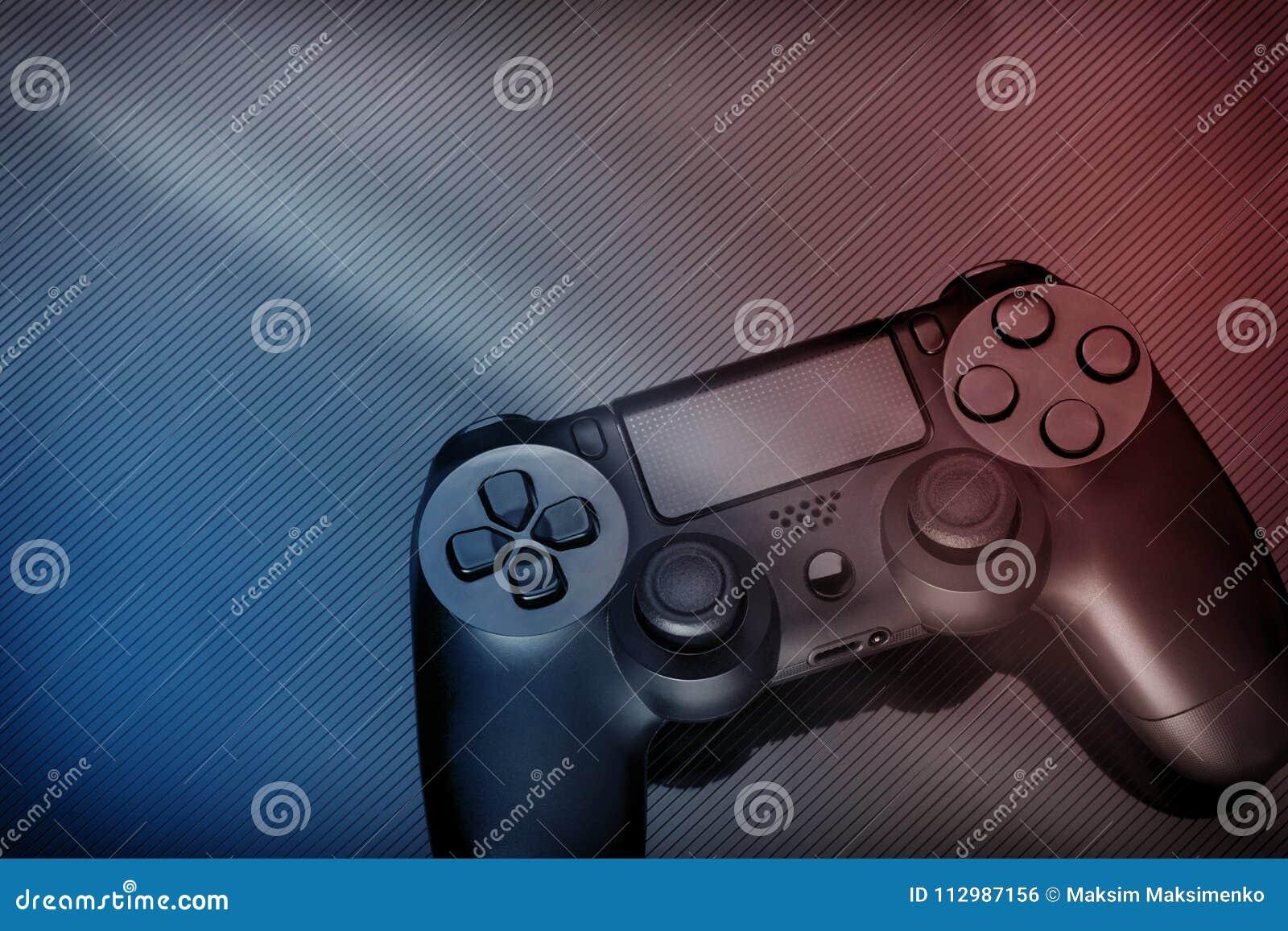 Black modern gamepad on dark background. Red-blue tinting