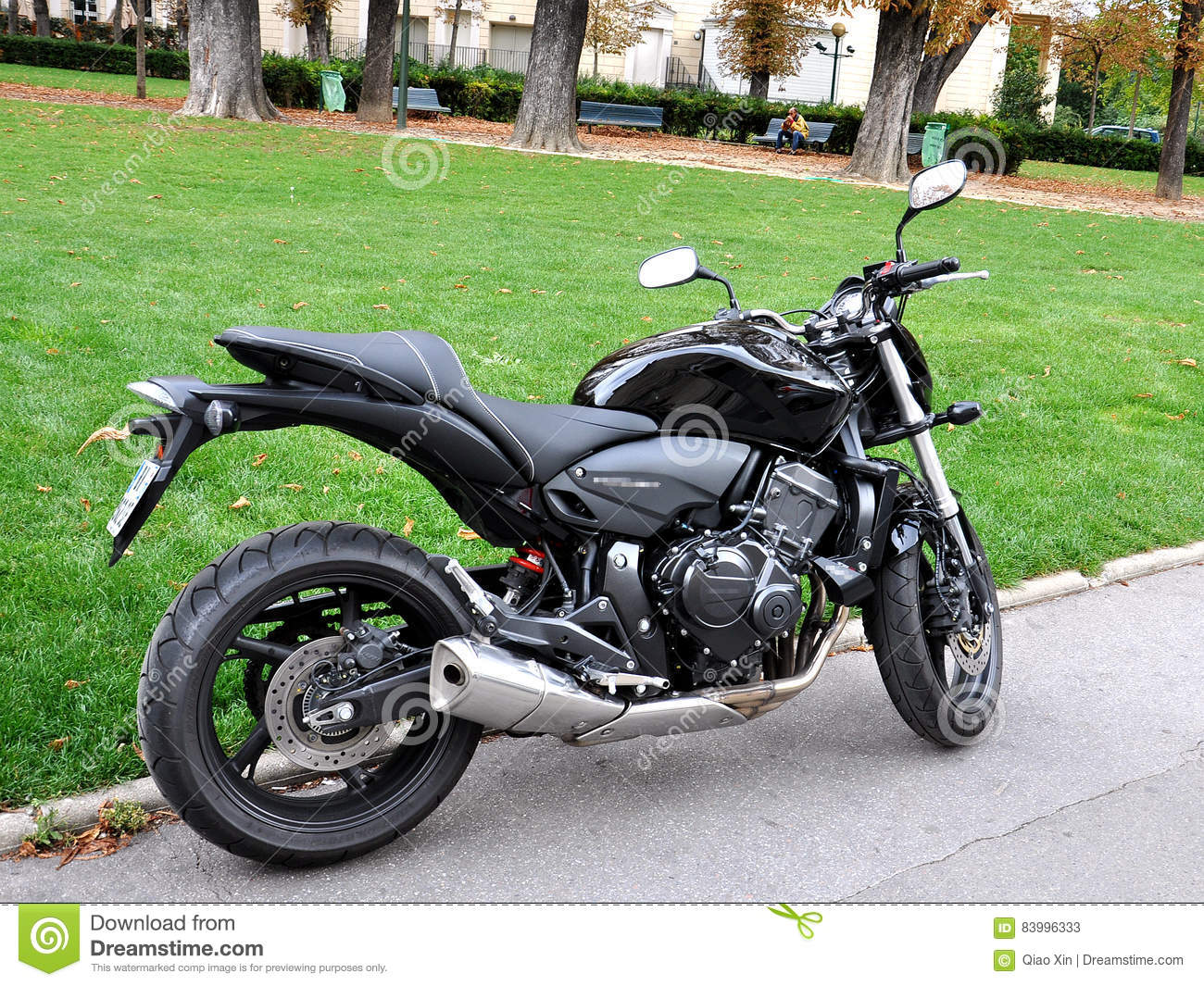 black motorcycle parked in the street of paris stock photo image 83996333. Black Bedroom Furniture Sets. Home Design Ideas