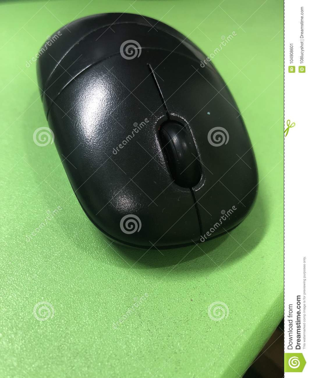Black mouse at the green background