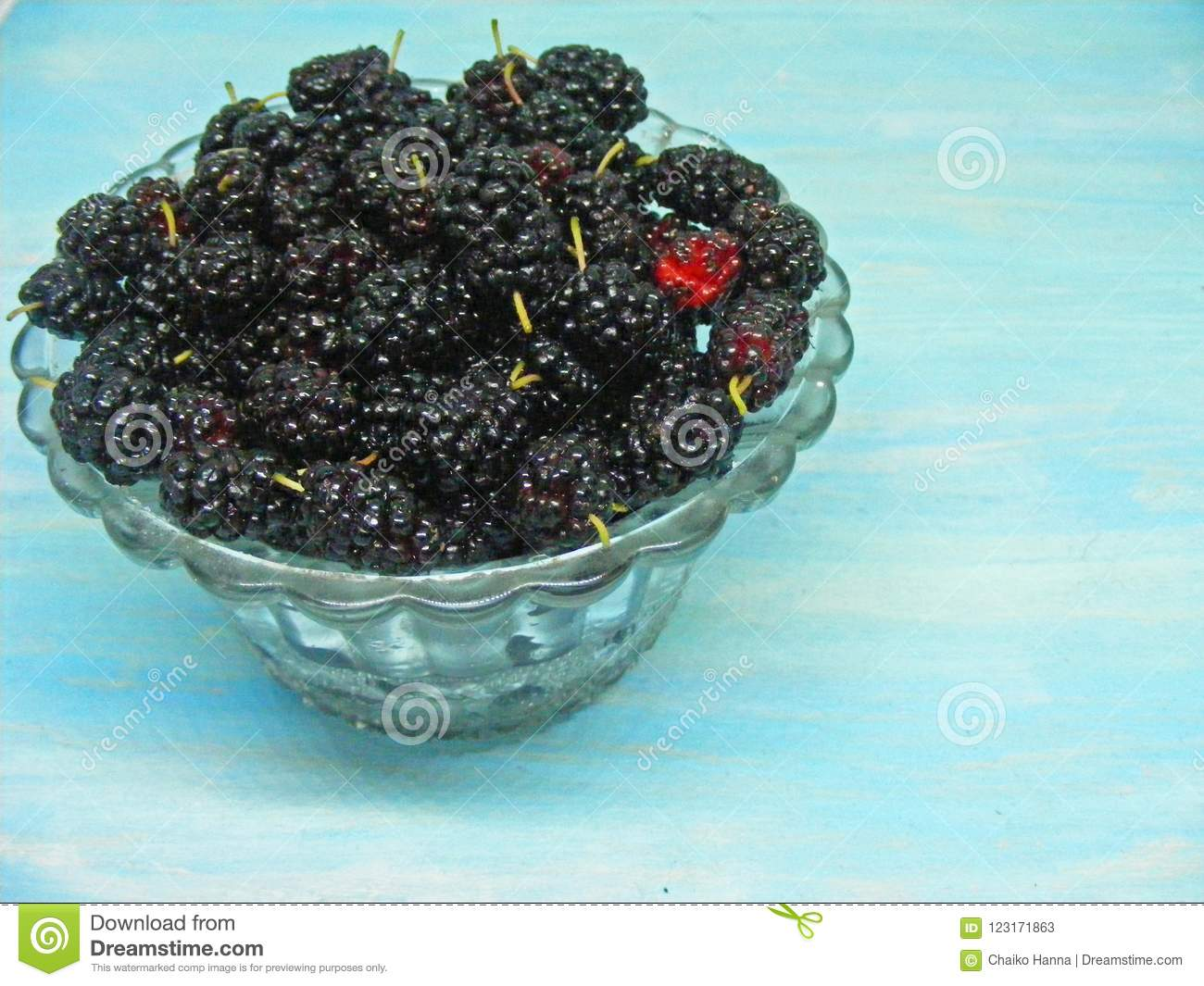 8565112d4642 Black Mulberry In Crystal Bowl On Shabby Blue Background Stock Image ...