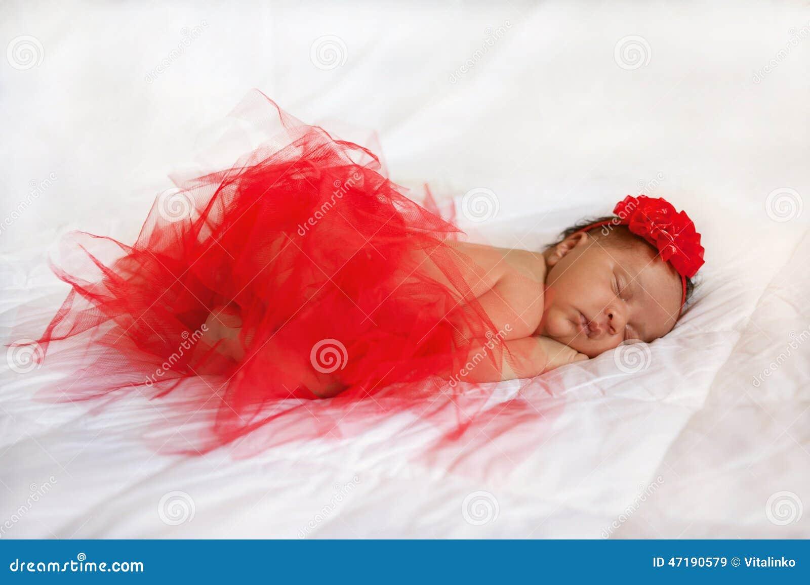 black small newborn baby sleeping royaltyfree stock