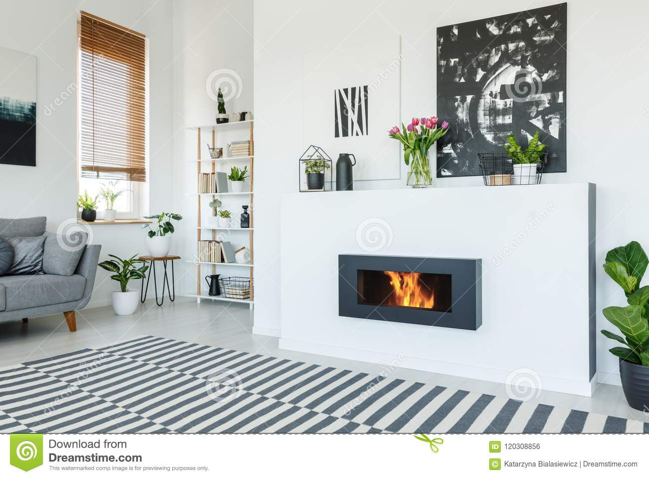 Modern Interieur Wit : Black painting above fireplace in white living room interior wit