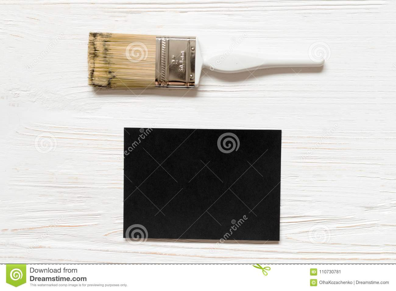 Black Paper Blank And Paintbrush On Wooden Background Mockup For