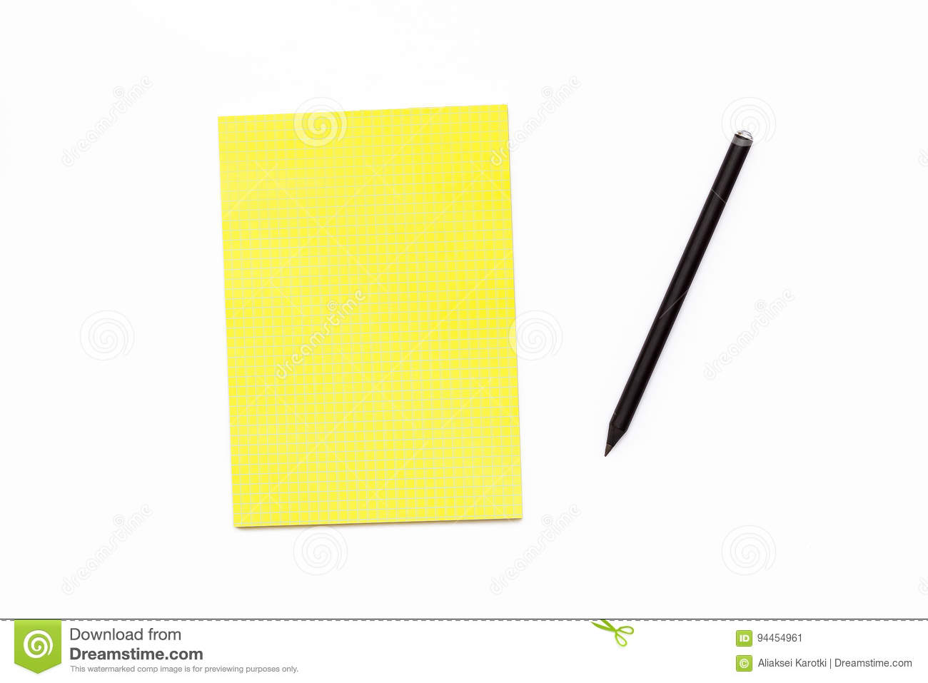 Black pencil and a yellow Notepad on a white background. Minimal business concept office Desk.
