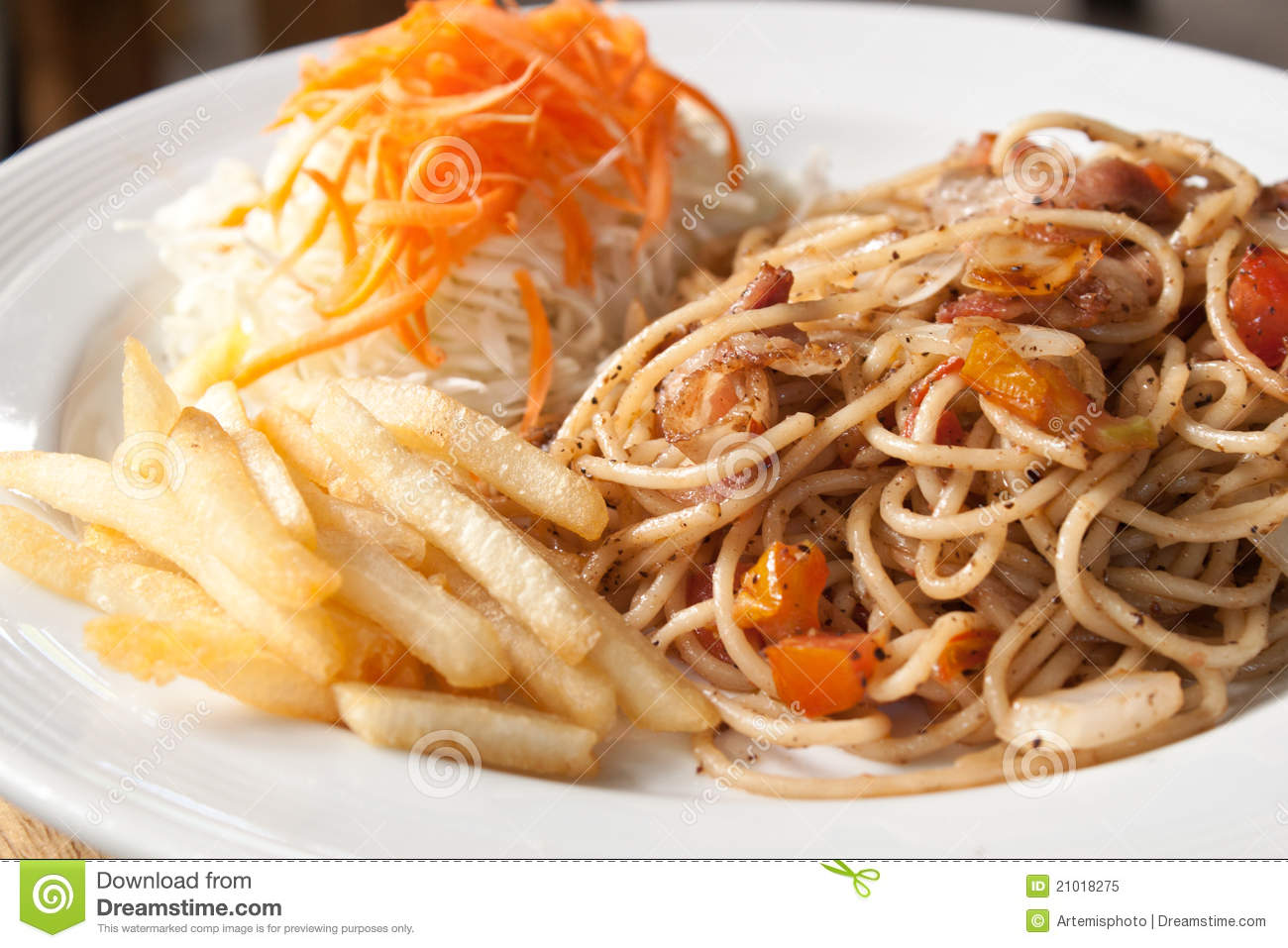 Black pepper and bacon spaghetti in plate with french fries and ...