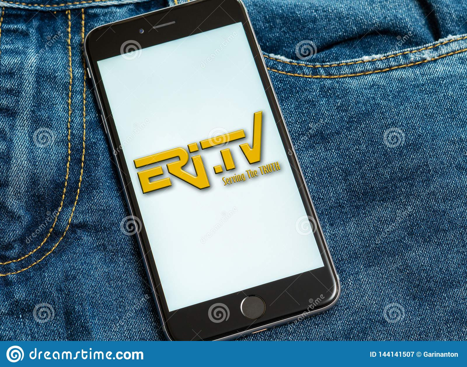 Black phone with logo of news media Eritrean Television Eri-TV on the screen.