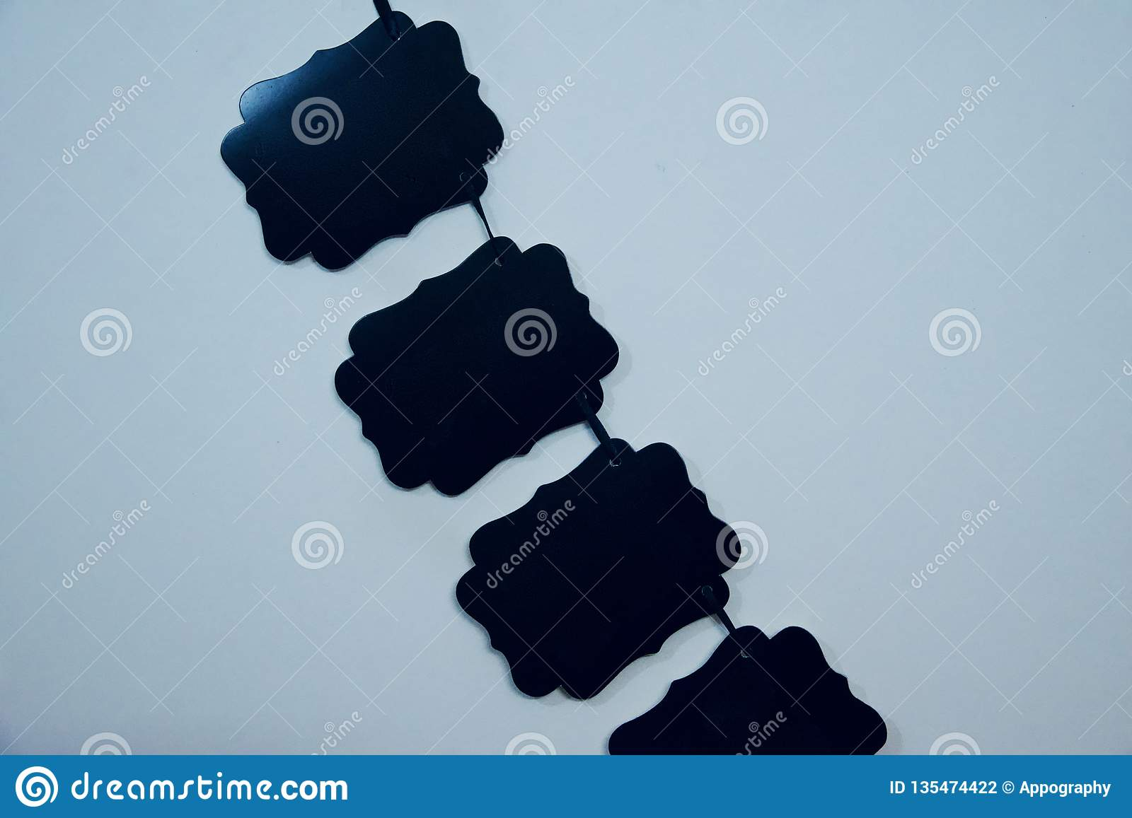 Black pieces of papers hanging on a wall
