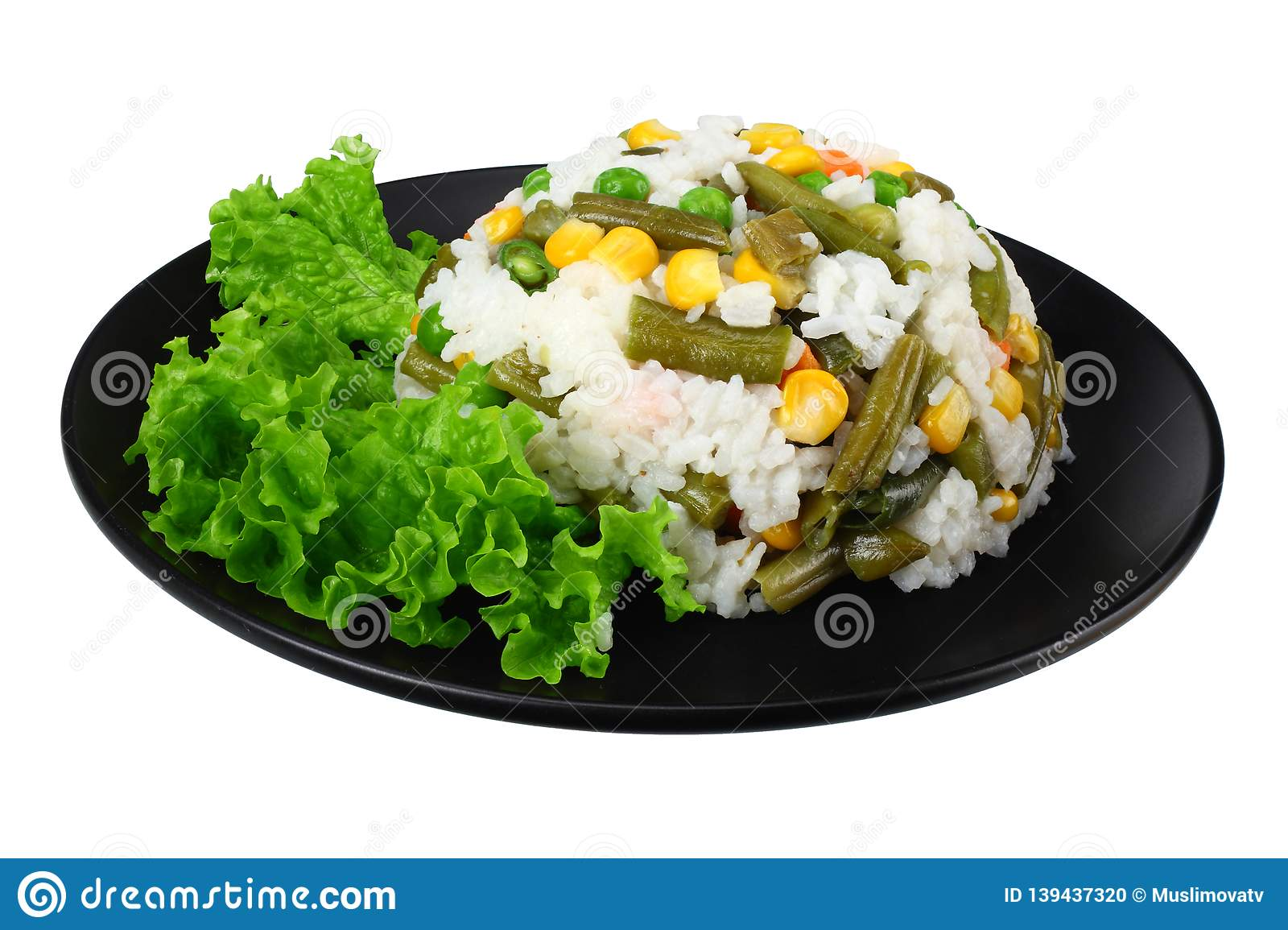 black plate with white rice, green peas, canned corn kernels, cut green beans isolated on white background