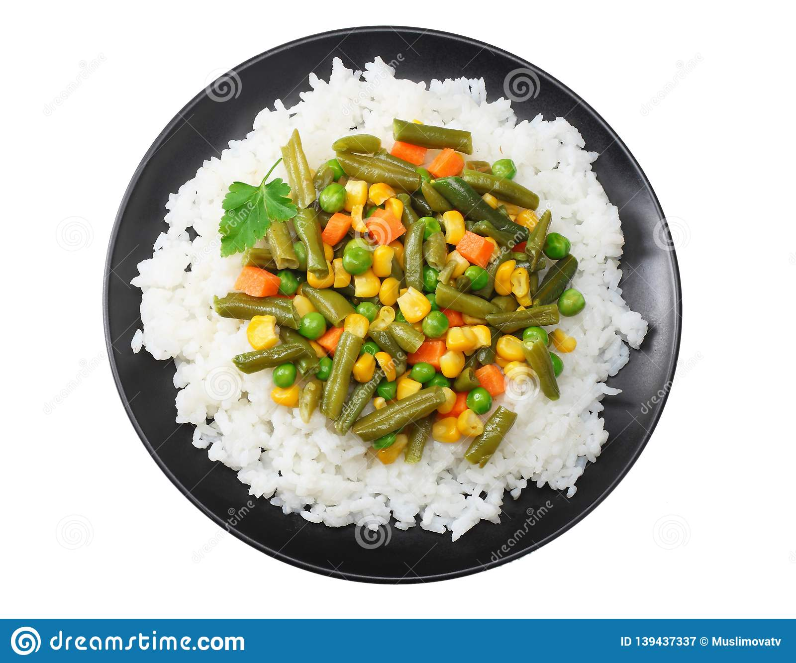 black plate with white rice, green peas, canned corn kernels, cut green beans isolated on white background. top view