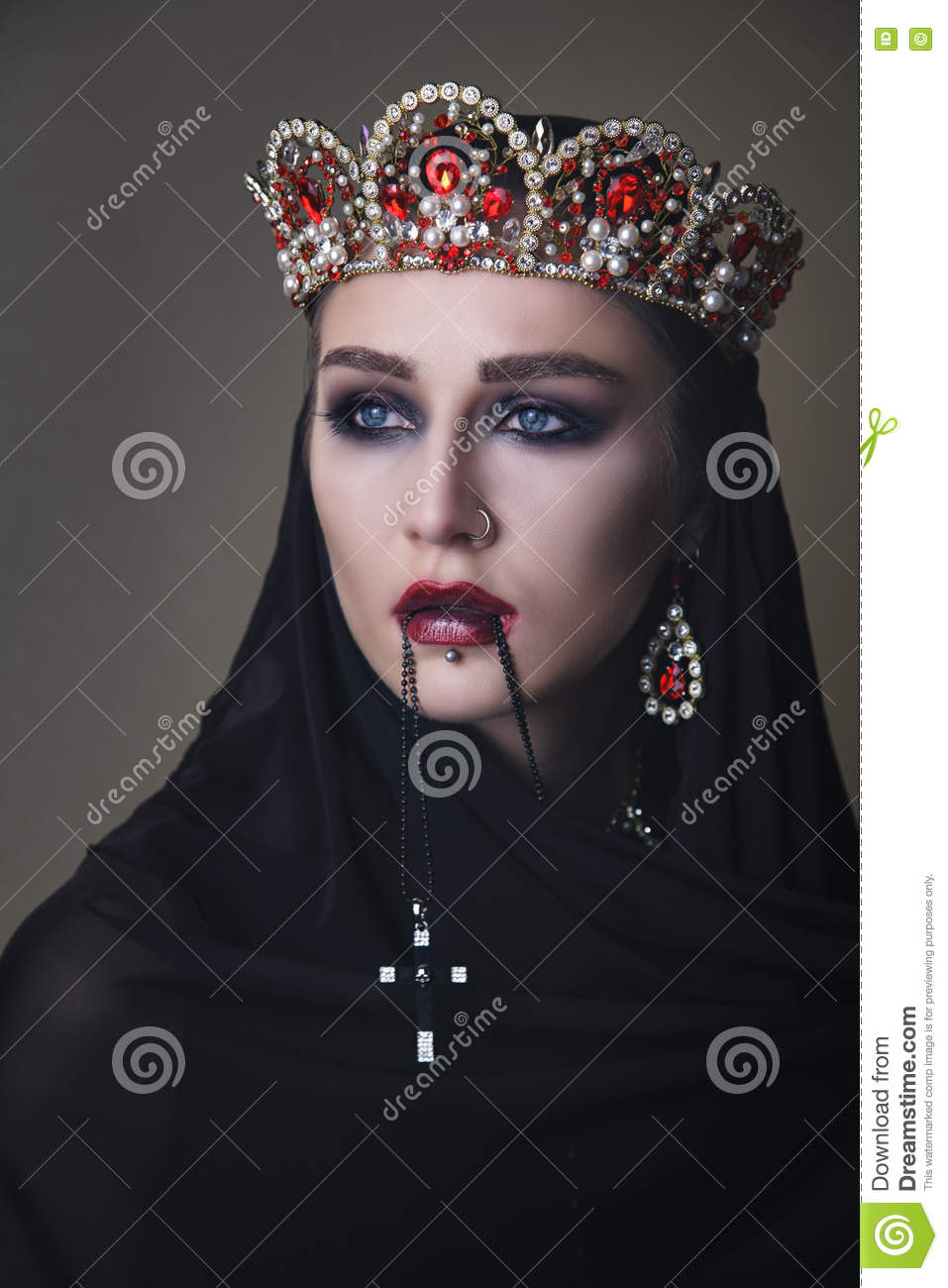 Black queen in a crown and with a crucifix