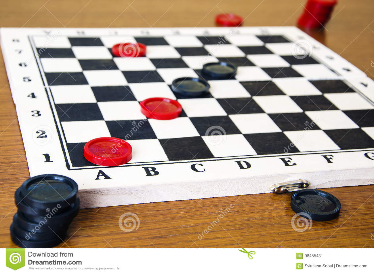 Black and red checkers on a game board