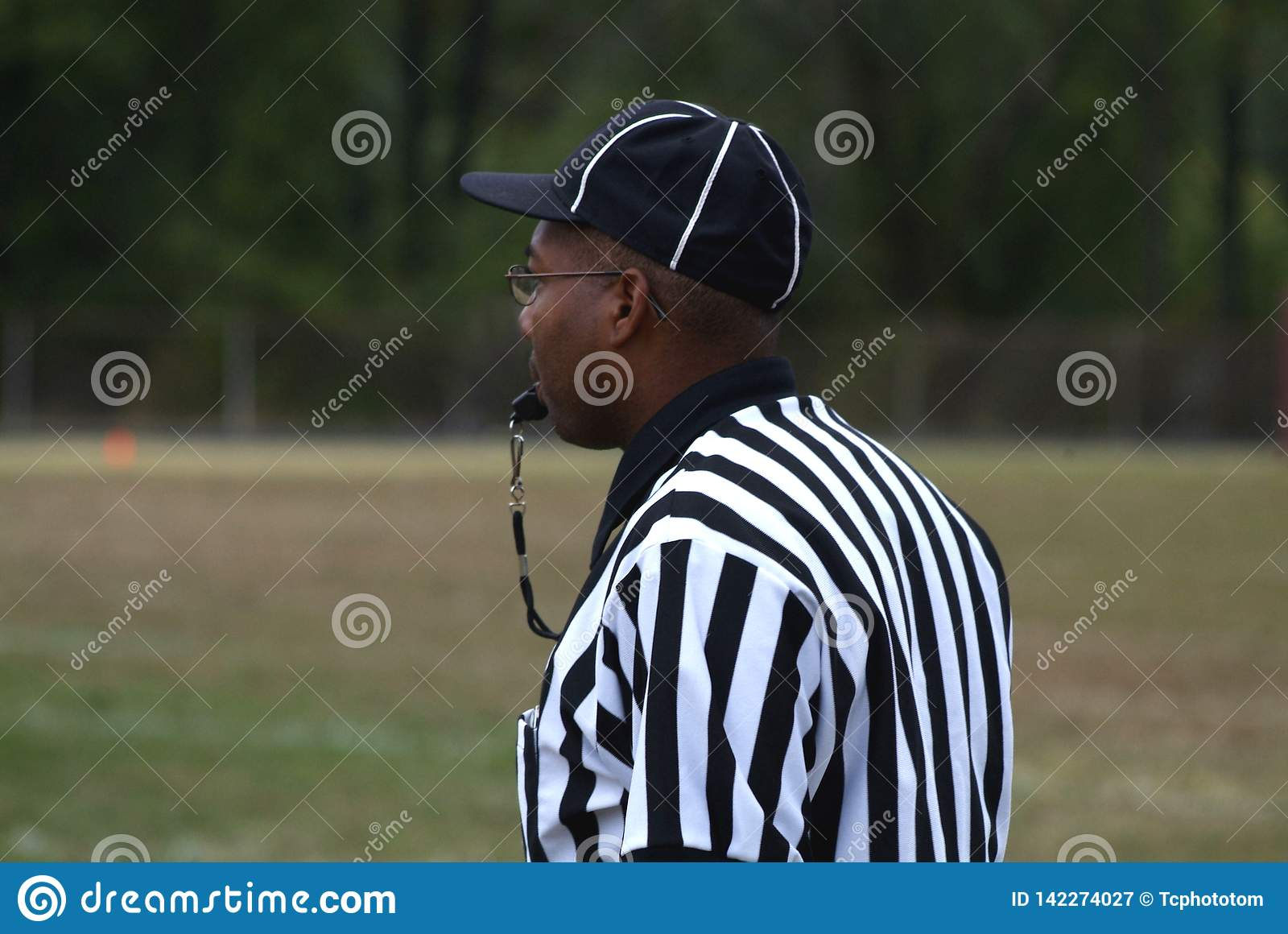 Black referees a game  at a high school football