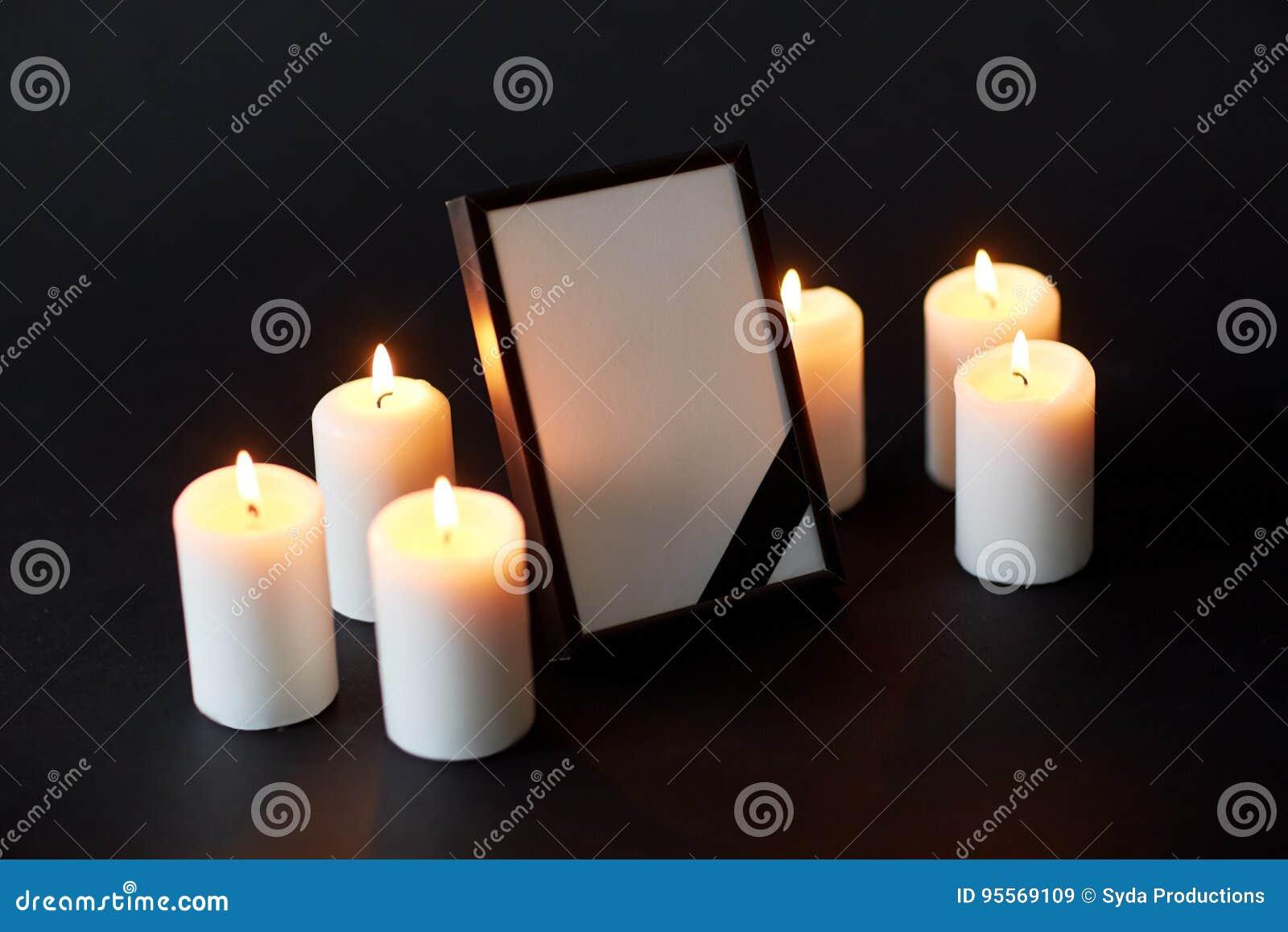 Black ribbon on photo frame and candles at funeral stock image black ribbon on photo frame and candles at funeral izmirmasajfo