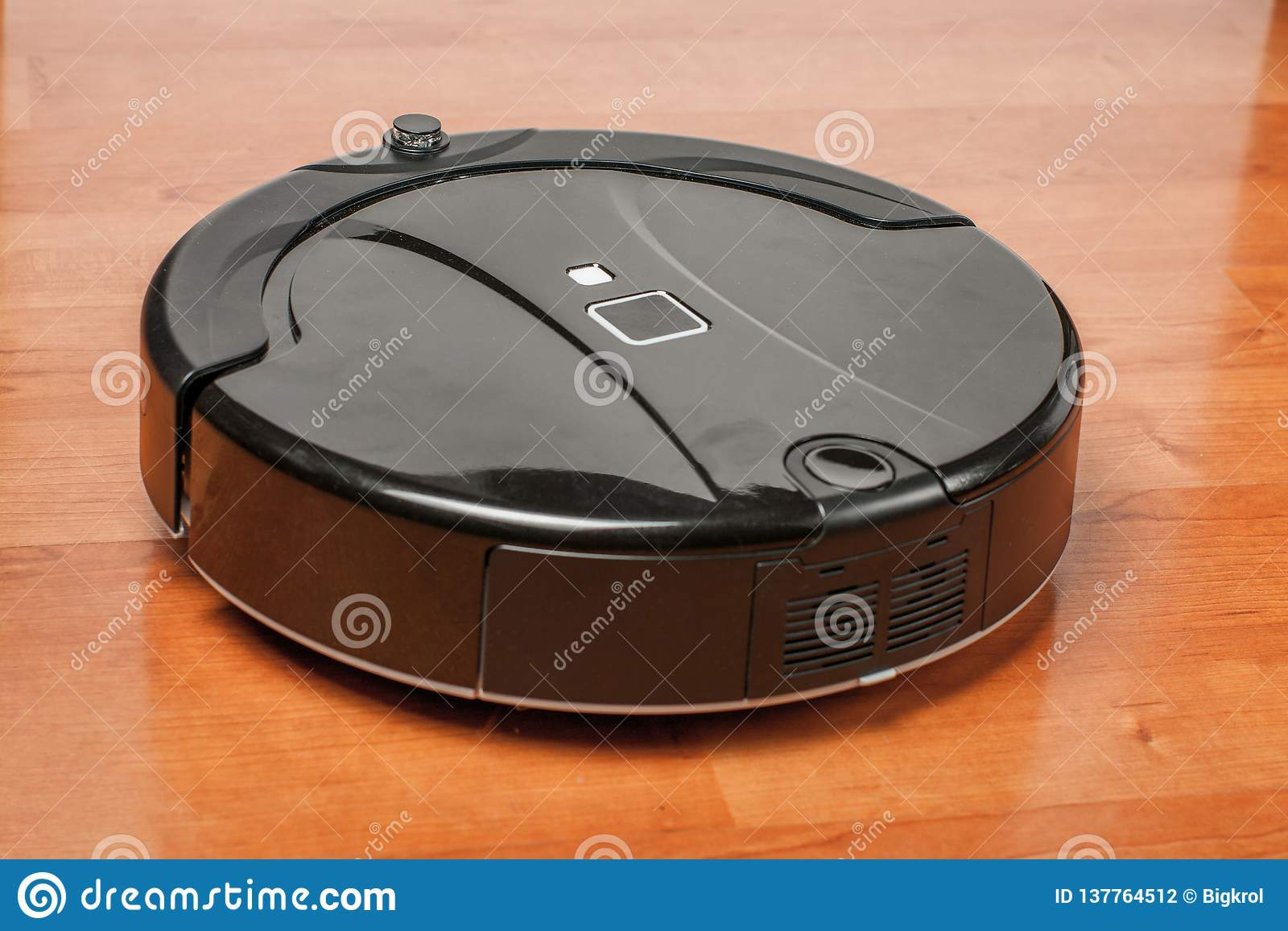 Black Robotic Vacuum Cleaner Runs On Laminate Floor Closeup  Robot