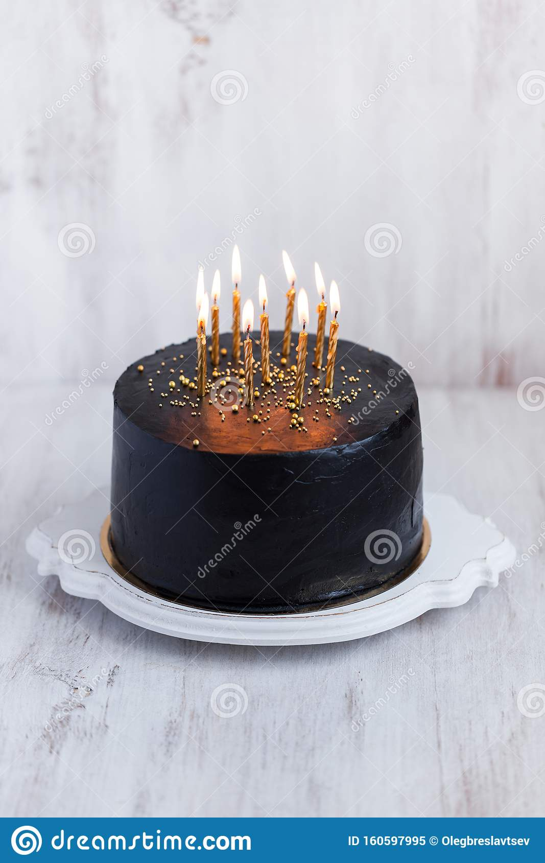 Fantastic Black Round Birthday Cake With Burning Golden Candles Close Up Funny Birthday Cards Online Inifodamsfinfo