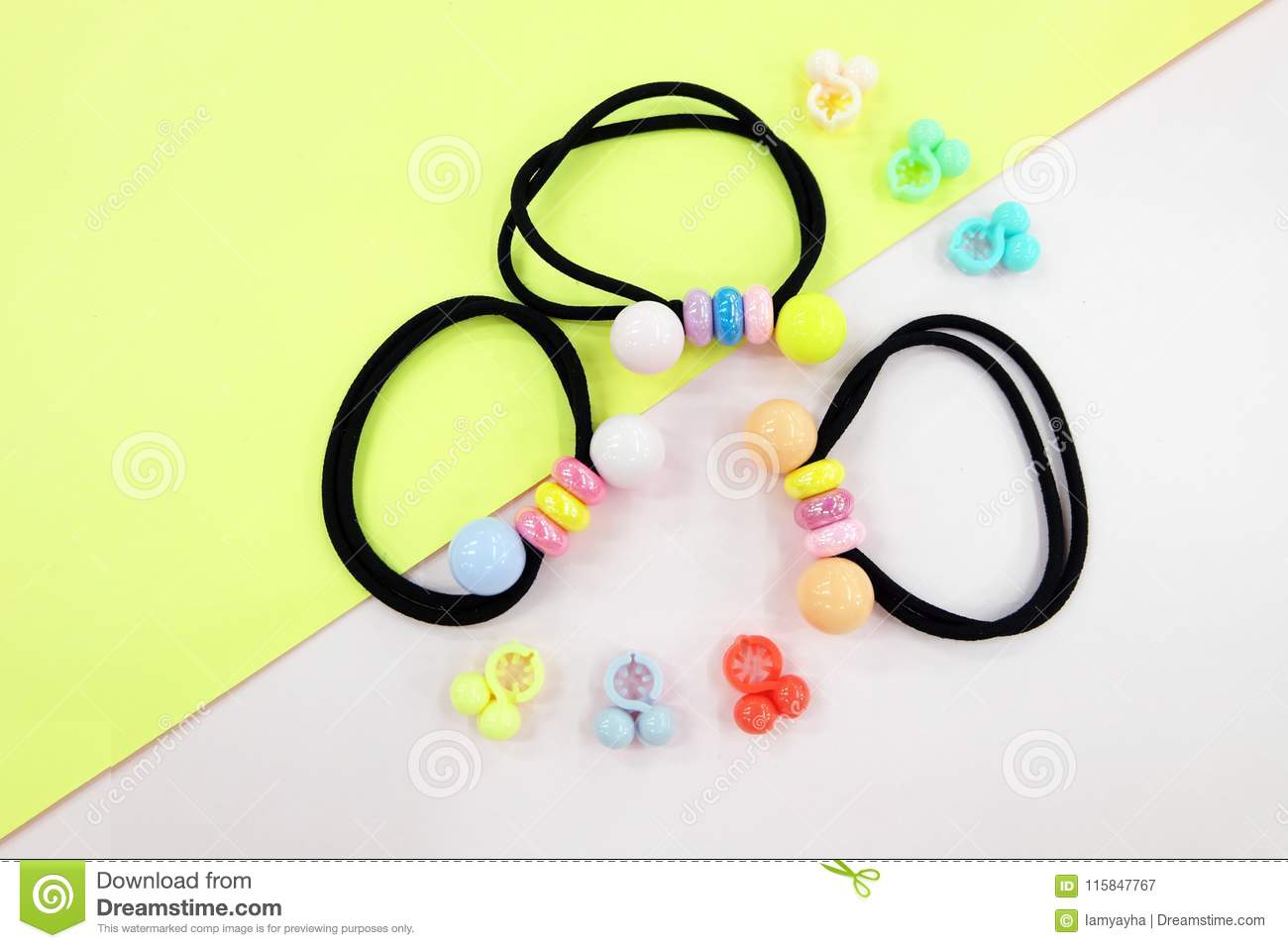 Black Rubber Band With Bead Fashion Accessories Hair Elastic Free Space Colorful Clip Isolated On Pink And Yellow