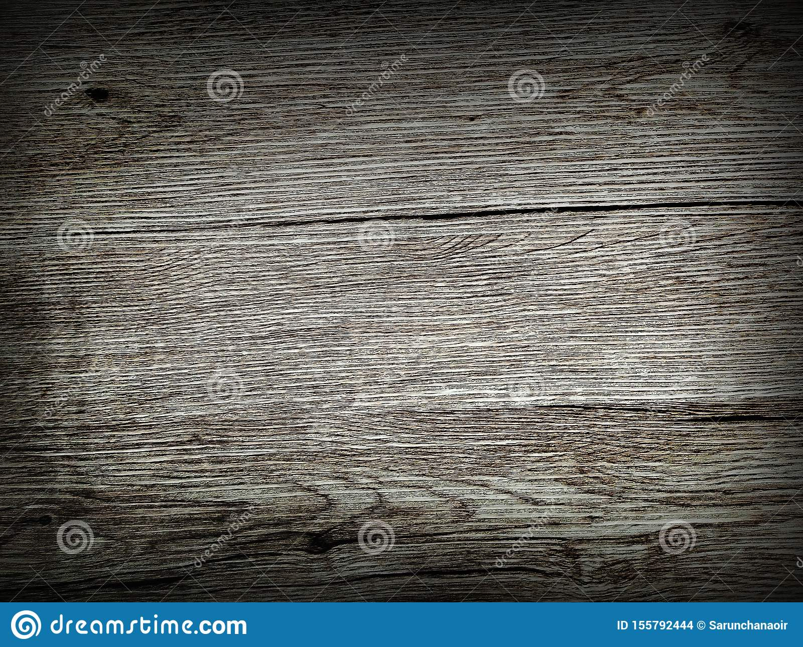 Black scratched wooden board. Wood background texture of board surface. A simple wallpaper to use in commercials