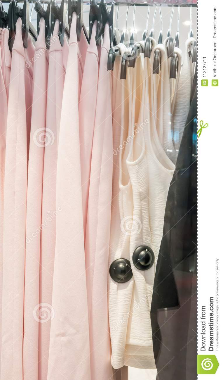 Black Security Tags Or Sensors On Clothing In Store Stock