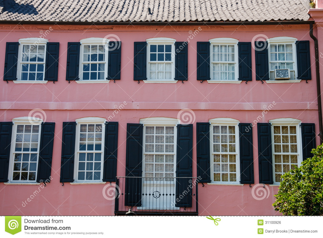 Black Shutters Pipe And Balcony On Pink Stucco Stock Photo