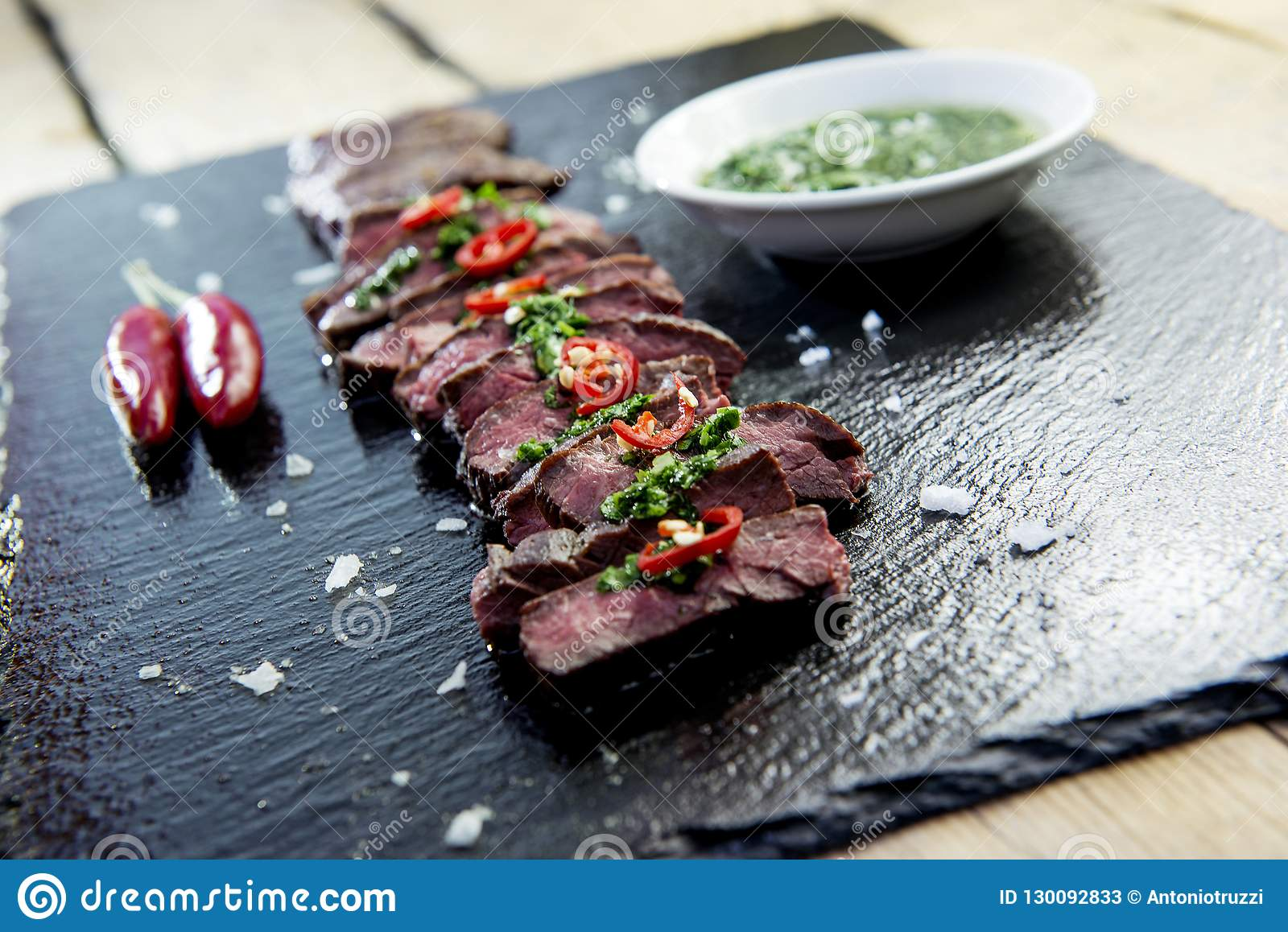 Black Stone Plate With Skirt Steak Pepper And Chimichurri Sauce Stock Image Image Of Food Cooked 130092833